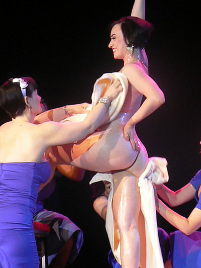 Michelle gets a post-performance rub down from her bridesmaids...