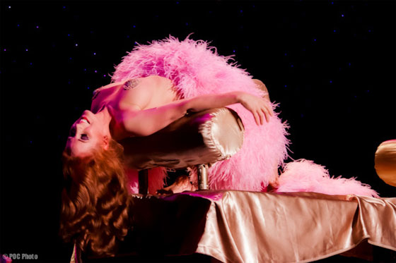 "Catherine D'Lish: ""A powdery, perfumed vision in a ruffled pink gown and matching boa...""  (©POC Photo)"