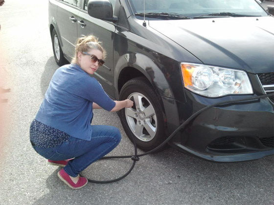 Anita Cookie, aka Miss Fix-It, giving our minivan, which we named Al (aka Ray-Ray for short) some TLC.