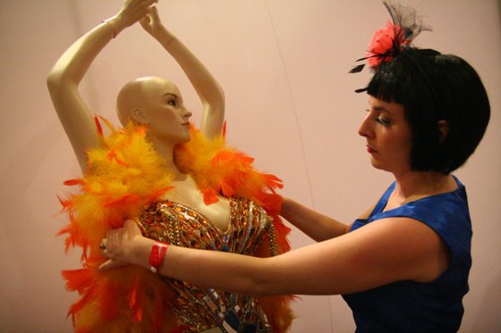 This is a shot of volunteer Diane Naegel in 2008, setting up a costume worn by Blaze Starr as part of an exhibit in the vending area at the Palms. I love this because it shows two things that I feel are most important about the museum: the collection of costumes, accessories and ephemera that make up the archives of the museum, badly in need of a permanent exhibit, and the vital need for volunteers to keep the pageant and the museum in existence. This shot means the most, it reminds me that the pageant weekend is primarily a showcase and fund raiser, and the real priority is the museum.  ©Don Spiro