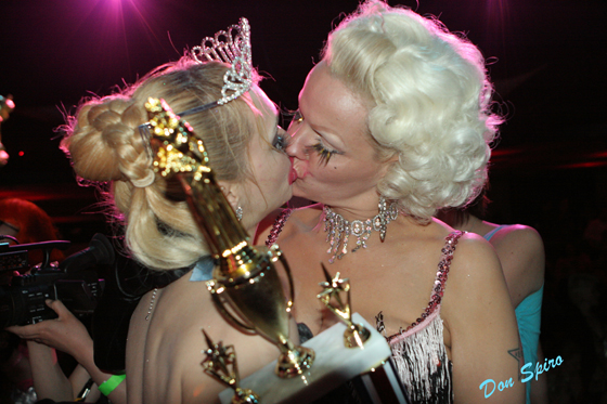 The World Famous *BOB* (2004's 2nd runner up) kisses Julie Atlas Muz after Julie's win in 2006. I met both of these ladies, and Tigger!, at the first Tease-O-Rama in New Orleans in 2001, when they were with the partnership of the Velvet Hammer and Miss Astrid's Va Va Voom Room. I got to know them better later that year at Velvet Hammer shows in Los Angeles and we've been friends ever since.  ©Don Spiro
