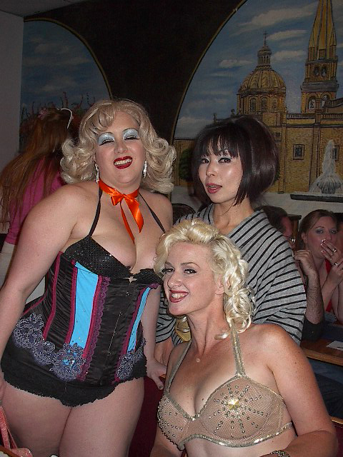Shot at the nearby Mexican food restaurant in Helendale after the main event, this is a shot of Miss Exotic World 2004 Dirti Martini, Miss Exotic World 2003 Erochica Bamboo and Miss Exotic World 2002 Kitten DeVille. Yes, we even took over neighborhood restaurants.   ©Chris Beyond