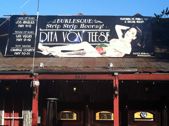 """""""Hovering over the 'shanty town' front porch in west Hollywood is the larger than life becrystalled Dita VonTeese...""""   ©Dirty Martini"""